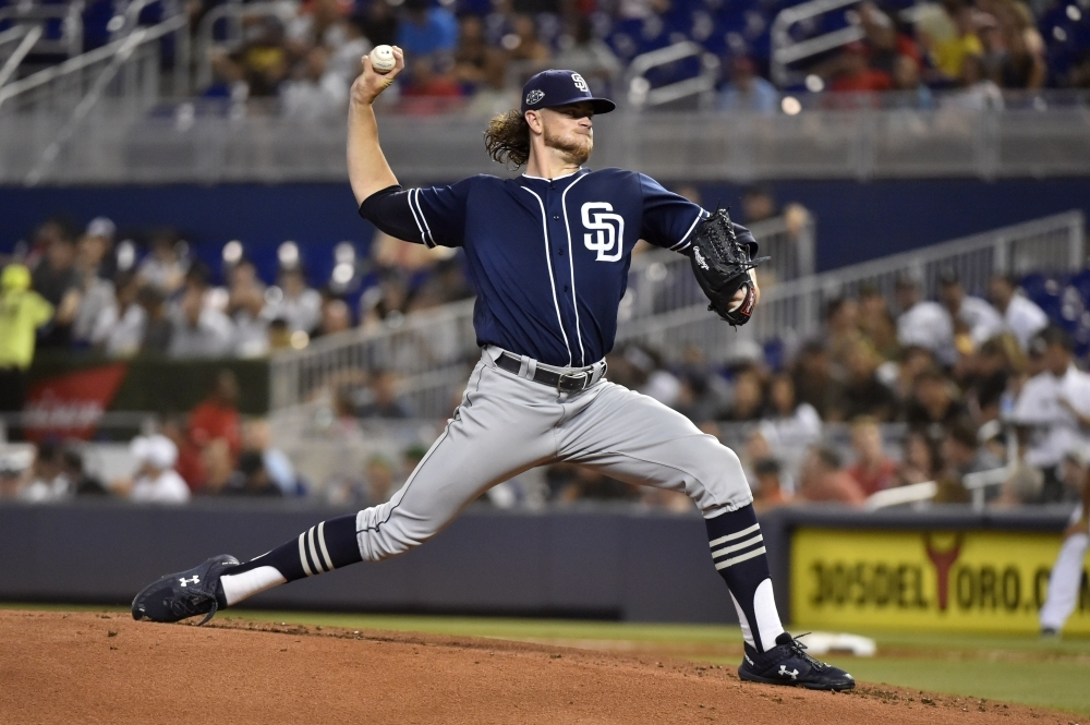 Chris Paddack No. 59 of the San Diego Padres throws a pitch during the game against the Miami Marlins at Marlins Park on Wednesday in Miami, Florida. — AFP