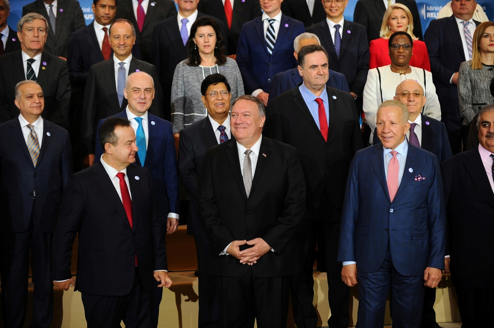 US Secretary of State Mike Pompeo poses in a family photo with participants of the Ministerial to Advance Religious Freedom in Dean Acheson Auditorium at the State Department in Washington, on Thursday. — Reuters