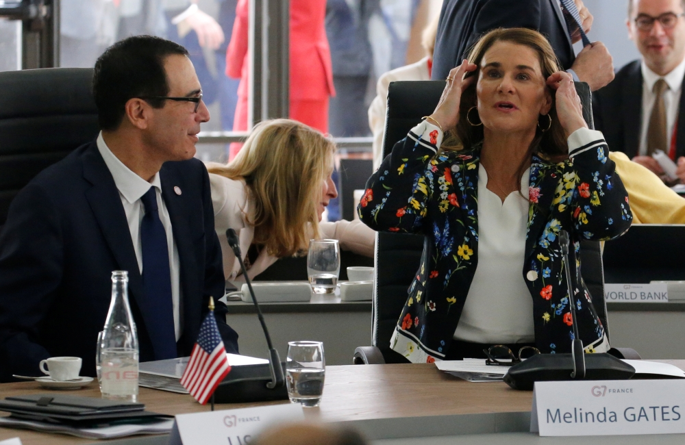 US Treasury Secretary Steven Mnuchin and philanthropist Melinda Gates, Co-Chair of the Bill and Melinda Gates Foundation, attend a meeting during the G7 finance ministers and central bank governors meeting in Chantilly, near Paris, France, on Thursday. — Reuters