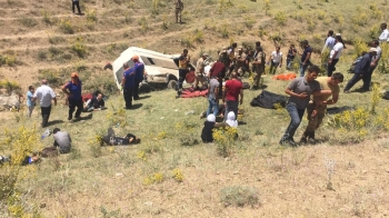 Turkish soldiers and medics carry wounded illegal migrants after a minibus crash in Van, Turkey, on Thursday. — Reuters