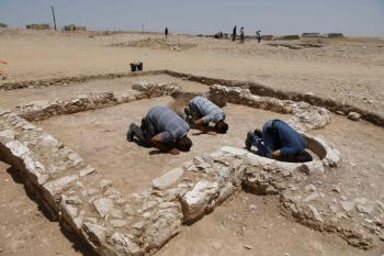 Muslim workers of Israel's antiquities authority pray at the newly discovered remains of an ancient rural mosque, dating back to the era between the 7th and the 8th centuries, in the Israeli Bedouin town of Rahat in the Negev desert on Thursday. — AFP
