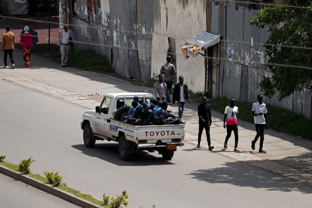 Armed security officers patrol the street during a clash in Hawassa, Ethiopia, on Thursday. — Reuters