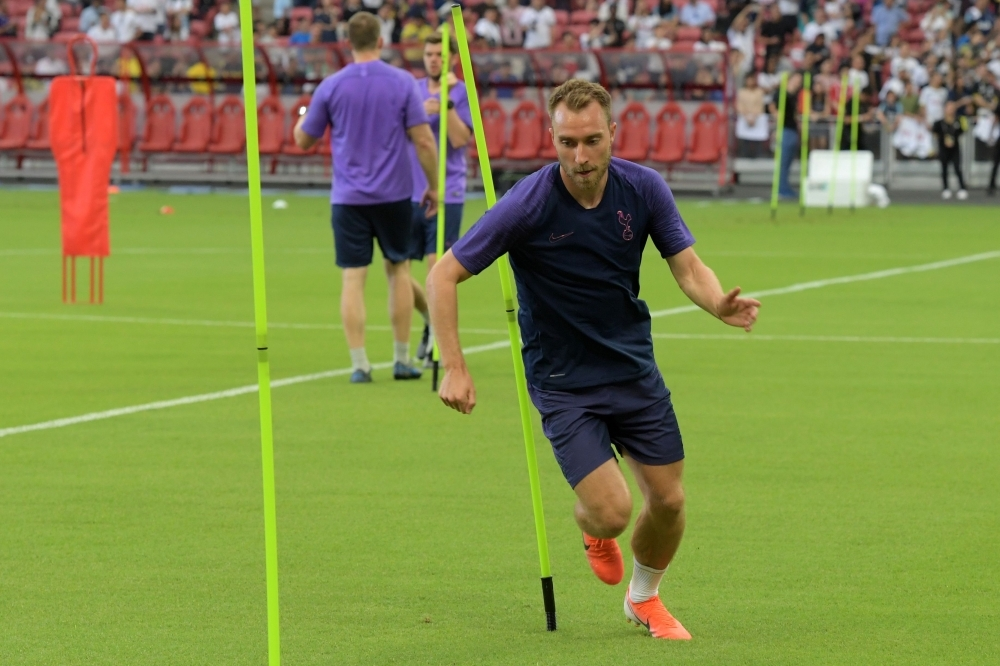 Tottenham Hotspur's Christian Eriksen warms up during an official football training session ahead of the International Champions Cup in Singapore on Friday. — AFP
