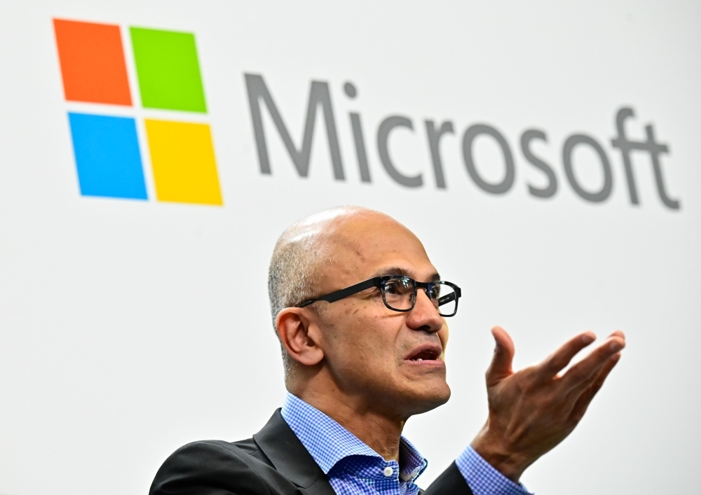 Microsoft CEO Satya Narayana Nadella speaks during a so-called Fireside-Chat with the CEO of German car-maker Volkswagen, unseen, where they unveiled their cooperation for the Volkswagen Automotive Cloud developed with Microsoft in this Feb. 27, 2019 file photo. — AFP
