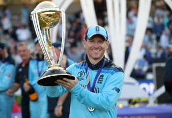 England's Eoin Morgan celebrates with the trophy after winning the  ICC Cricket World Cup at Lord's. London, Britain, on Sunday. — Reuters