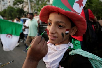 An Algeria fan in Cairo has his face painted ahead of the Africa Cup of Nations 2019 - Final against Senegal in Cairo, Egypt  on Friday. — Reuters