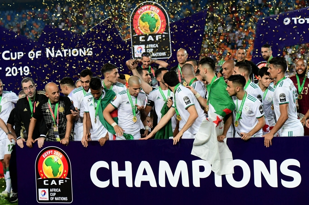 Algerian players celebrate after winning the 2019 Africa Cup of Nations final football match between Senegal and Algeria at the Cairo International Stadium in Cairo on Friday. –AFP