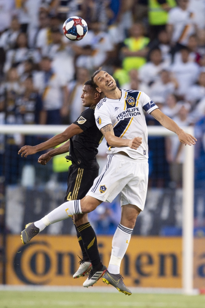 LA Galaxy forward Zlatan Ibrahimovic (9) and Los Angeles FC defender Eddie Segura (4) battle for the header during the first half at Dignity Health Sports Park, Carson, CA, USA, on Friday. — Reuters