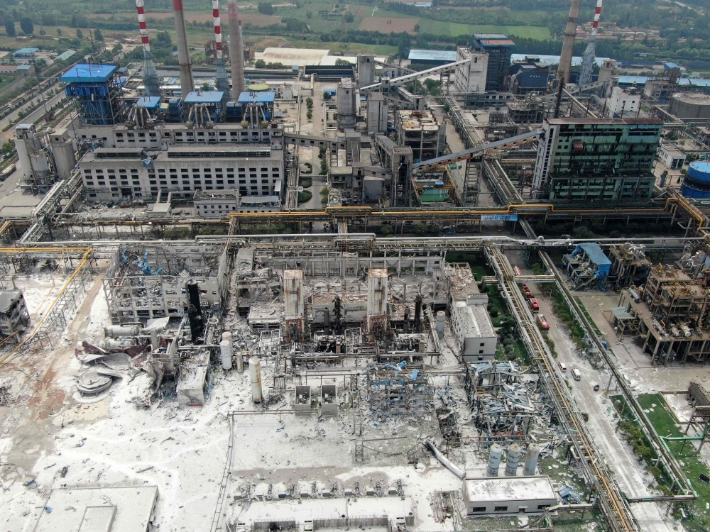 Damaged buildings are seen at the site of an explosion at the Henan Coal Gas Group factory in Yima city, in China's central Henan province on Saturday. — AFP