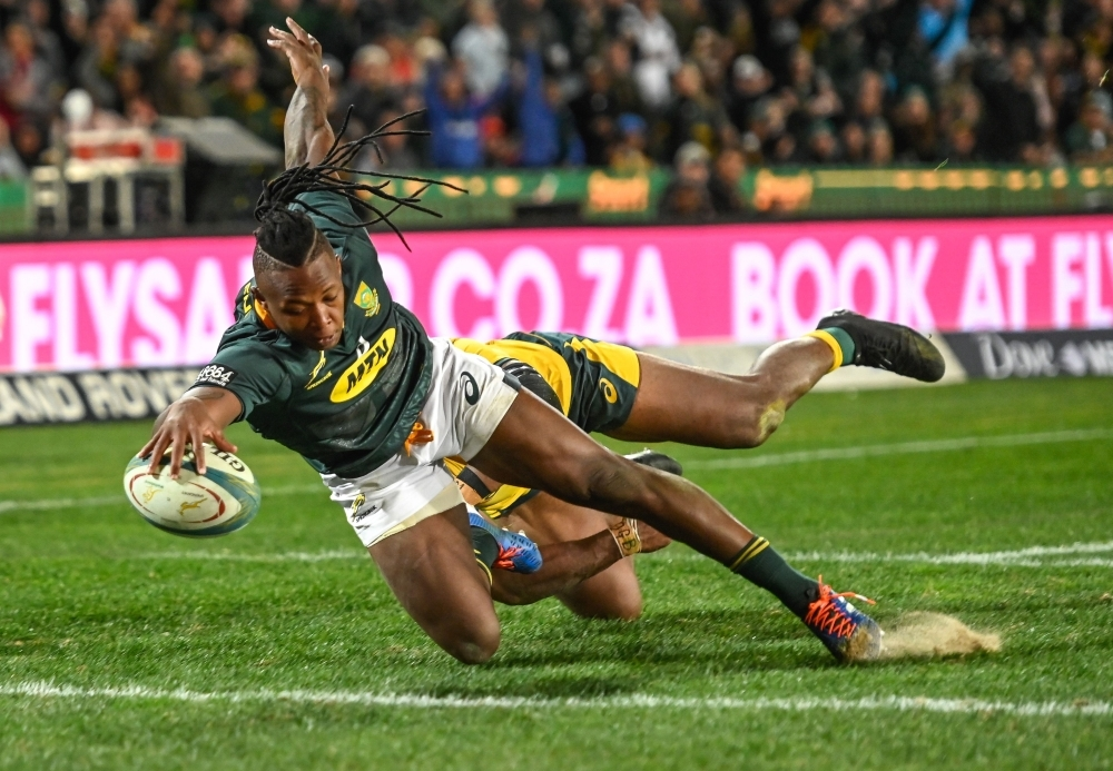 South Africa's Herschel Jantjies scores his try during the 2019 Rugby Championship match South Africa v Australia, at the Emirates Airline Park in Johannesburg, on Saturday. — AFP