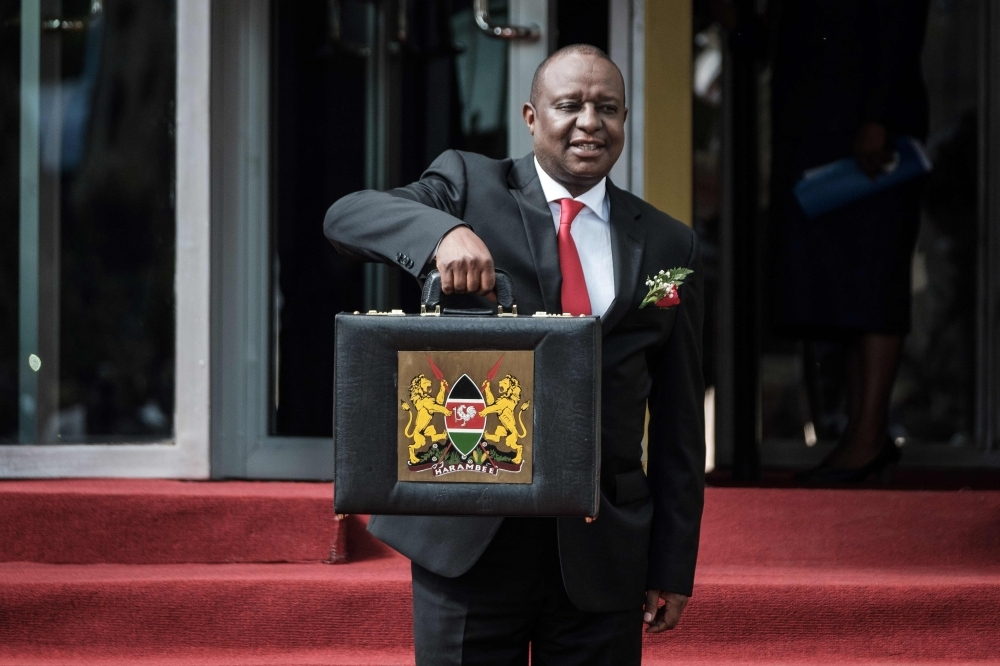 In this file photo taken on June 14, 2018, Kenya's Cabinet Secretary for National Treasury Henry Rotich poses with the budget briefcase before leaving for Parliament to read the budget speech for 2018-2019 in Nairobi, Kenya. -AFP photo
