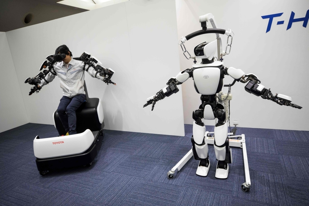 In this picture, Toyota Motor Corp. demonstrates the T-HR3 humanoid robot which will be used during the Tokyo 2020 Olympic and Paralympic Games, in Tokyo. — AFP