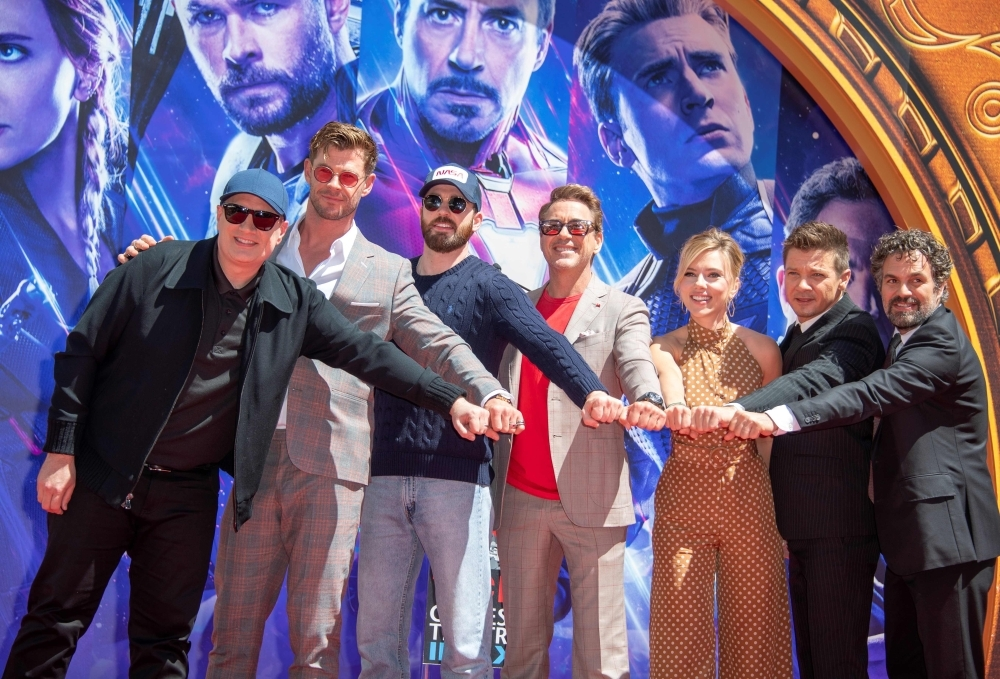 In this file photo taken on April 23, 2019 (From L-R) President of Marvel Studios/Producer Kevin Feige, actors  Chris Hemsworth, Chris Evans, Robert Downey Jr., Scarlett Johansson, Mark Ruffalo and Jeremy Renner attend the Marvel Studios' 'Avengers: Endgame' hand print ceremony at TCL Chinese Theater IMAX Forecourt in Hollywood. — AFP
