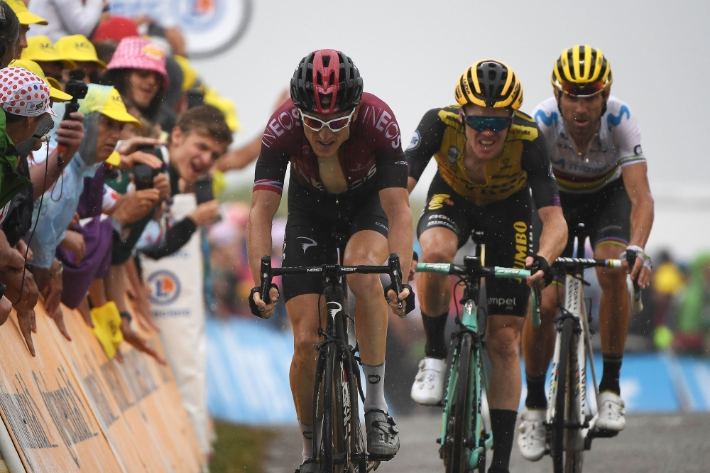 (From Left) Great Britain's Geraint Thomas, Netherlands' Steven Kruijswijk and Spain's Alejandro Valverde make a last effort in the last meters to the finish line of the fifteen stage of the 106th edition of the Tour de France cycling race between Limoux and Foix Prat d'Albis, in Foix Prat d'Albis on Sunday. — AFP