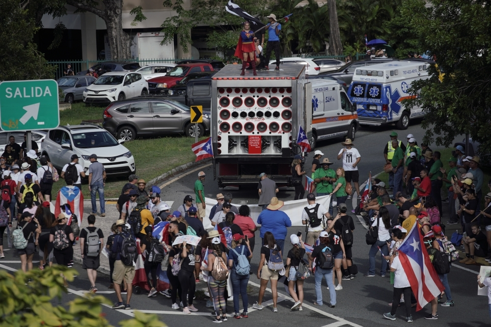 People take to the Las Americas Highway in San Juan, Puerto Rico, on Monday on day 9th of continuous protests demanding the resignation of Governor Ricardo Rossellَ. — AFP