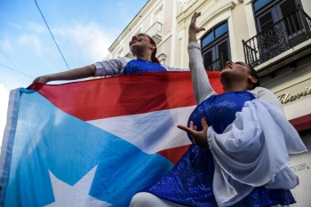 Demonstrators protest for the resignation of Puerto Rico's governor Ricardo Rossello in San Juan, Puerto Rico on Sunday. -Reuters photo