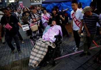 Reiwa Shinsengumi's disabled candidate for Japan's upper house election Yasuhiko Funago, who has amyotrophic lateral sclerosis (ALS), attends an election rally in Tokyo, Japan, in this July 12, 2019, photo. — Reuters