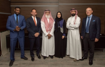 Dr. Adel Abdul Jalil Batterjee (third from left), Chairman of the Board of Directors of Waad Holding Company, poses with some executives