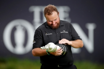 Republic of Ireland's Shane Lowry celebrates with the Claret Jug trophy after winning the Open Championship at Royal Portrush Golf Club, Portrush, Northern Ireland, on Sunday. — Reuters