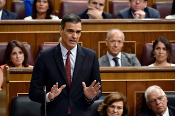 Candidate for re-election as prime minister for a second term, socialist Pedro Sanchez, speaks during the first day of the parliamentary investiture debate to vote through a prime minister, at the Spanish Congress (Las Cortes) in Madrid on Monday. — AFP