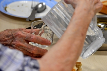 People serve water to each others in a residence for elderly people in Bordeaux, southwestern France, on Monday during a heat wave in the region. — AFP