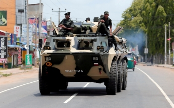 Sri Lankan soldiers patrol a road of Hettipola after a mob attack in a mosque in the nearby village of Kottampitiya, Sri Lanka, in this May 14, 2019 file photo. — Reuters