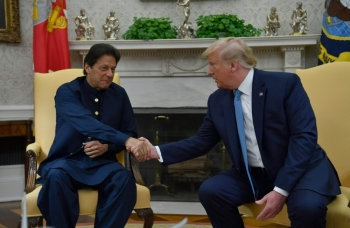 US President Donald Trump meets with Pakistani Prime Minister Imran Khan, left, in the Oval Office at the White House in Washington on Monday. — AFP