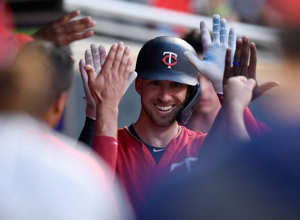 Mitch Garver of the Minnesota Twins celebrates hitting a solo home run against the New York Yankees during the fourth inning of the game at Target Field in Minneapolis, Minnesota, on Monday. — AFP