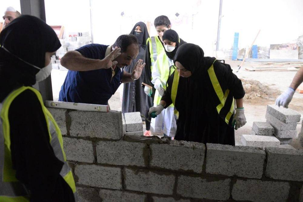 Saudi female engineers getting hands-on field training. — Okaz photo