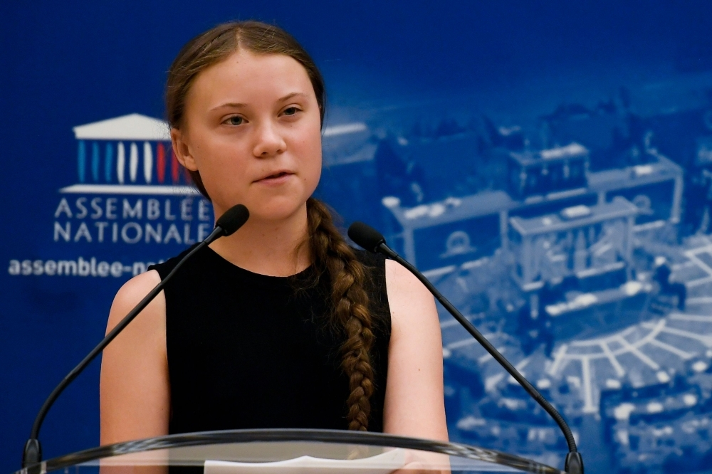 Swedish climate activist Greta Thunberg delivers a speech during a visit of the French National Assembly, in Paris, on Tuesday. -AFP photo
