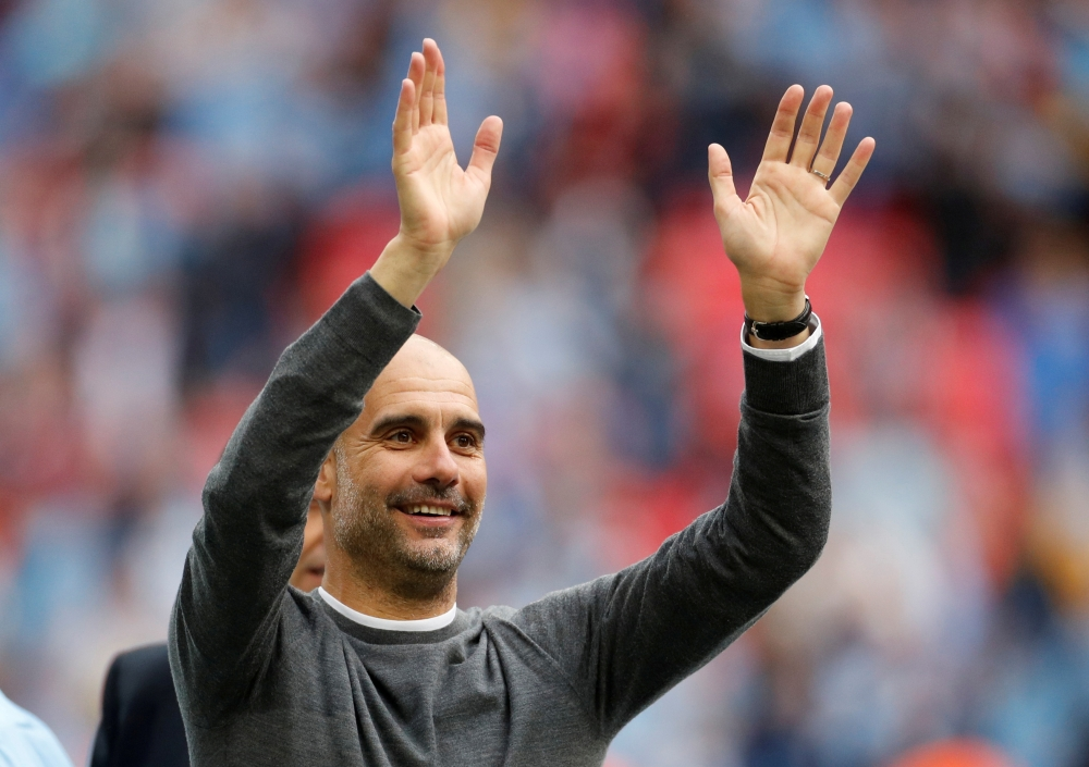 Manchester City manager Pep Guardiola celebrates after winning the FA Cup final match against Watford at Wembley Stadium, London, Britain, in this May 18, 2019 file photo. — Reuters