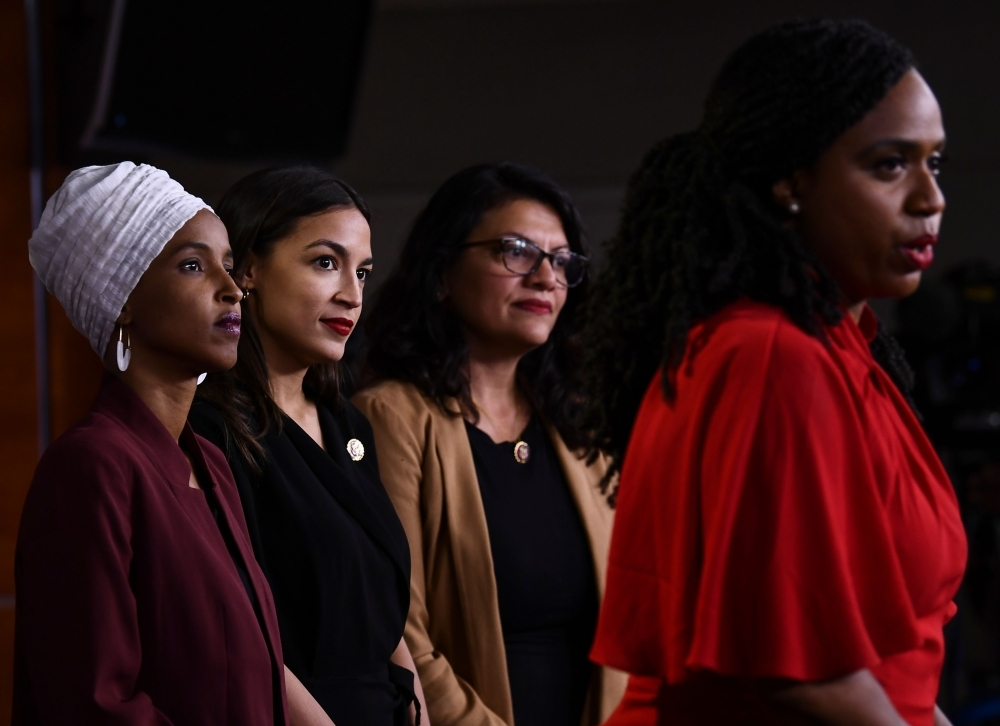 US Representatives Ayanna Pressley speaks as, Ilhan Abdullahi Omar, left, Rashida Tlaib, second right, and Alexandria Ocasio-Cortez hold a press conference, to address remarks made by US President Donald Trump earlier in the day, at the US Capitol in Washington, in this July 15, 2019 file photo. — AFP