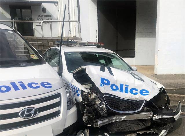 A clumsy driver led police to a drug bust in Australia after he crashed a van laden with methamphetamines into a patrol car parked outside a police station in suburban Sydney.