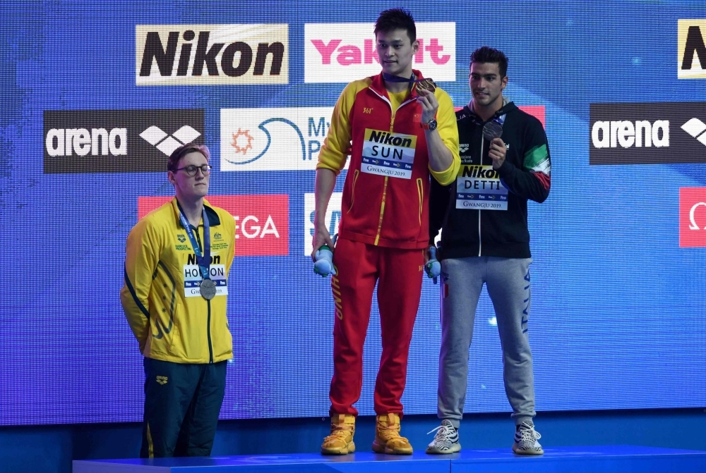 In this file photo taken on July 21, 2019 Silver medalist Australia's Mack Horton (L) refuses to stand on the podium with gold medalist China's Sun Yang (C) and bronze medalist Italy's Gabriele Detti after the final of the men's 400m freestyle event during the swimming competition at the 2019 World Championships at Nambu University Municipal Aquatics Center in Gwangju, South Korea, in this July 21, 2019 file photo. — AFP