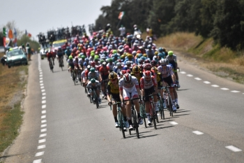 The pack rides during the sixteenth stage of the 106th edition of the Tour de France cycling race between Nimes and Nimes, in Nimes, on Tuesday. It will be hot work for the peloton in the Tour de France as temperatures hit the 40 degrees mark this week. — AFP