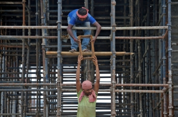 Laborers work at the construction site of a residential building on the outskirts of Kolkata, India, in this July 5, 2019 file photo. — Reuters