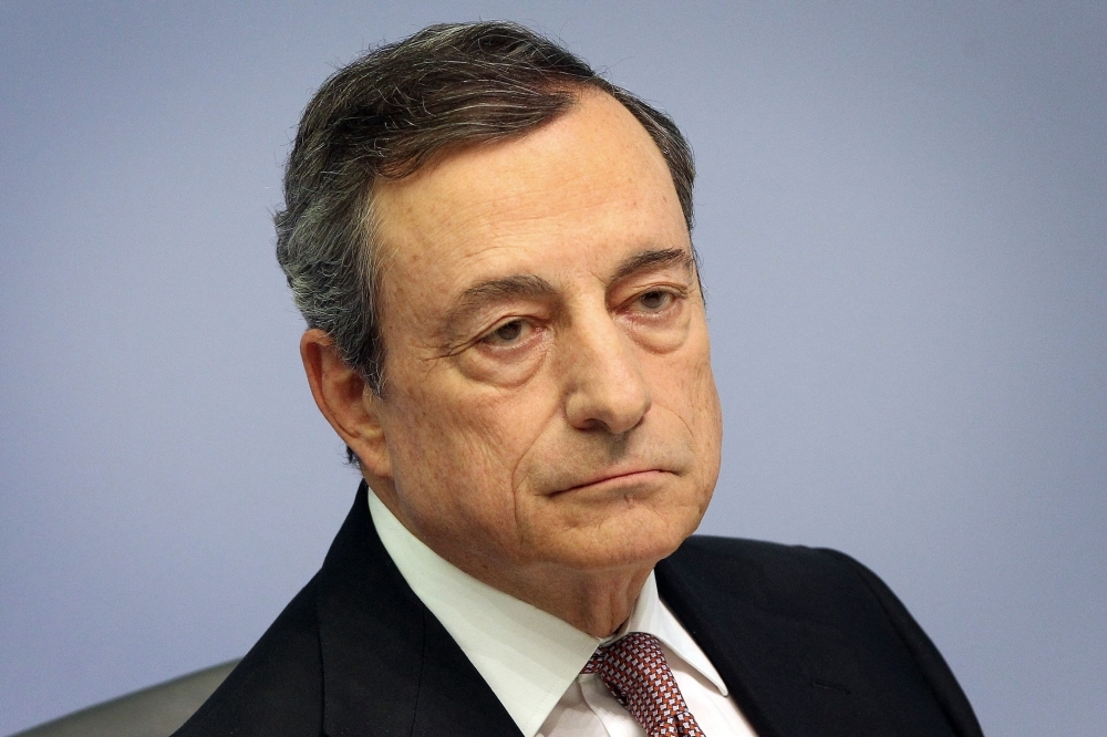 Mario Draghi, president of the European Central Bank, looks on during a press conference on Eurozone monetary policy in Frankfurt am Main, western Germany, on Thursday. — AFP
