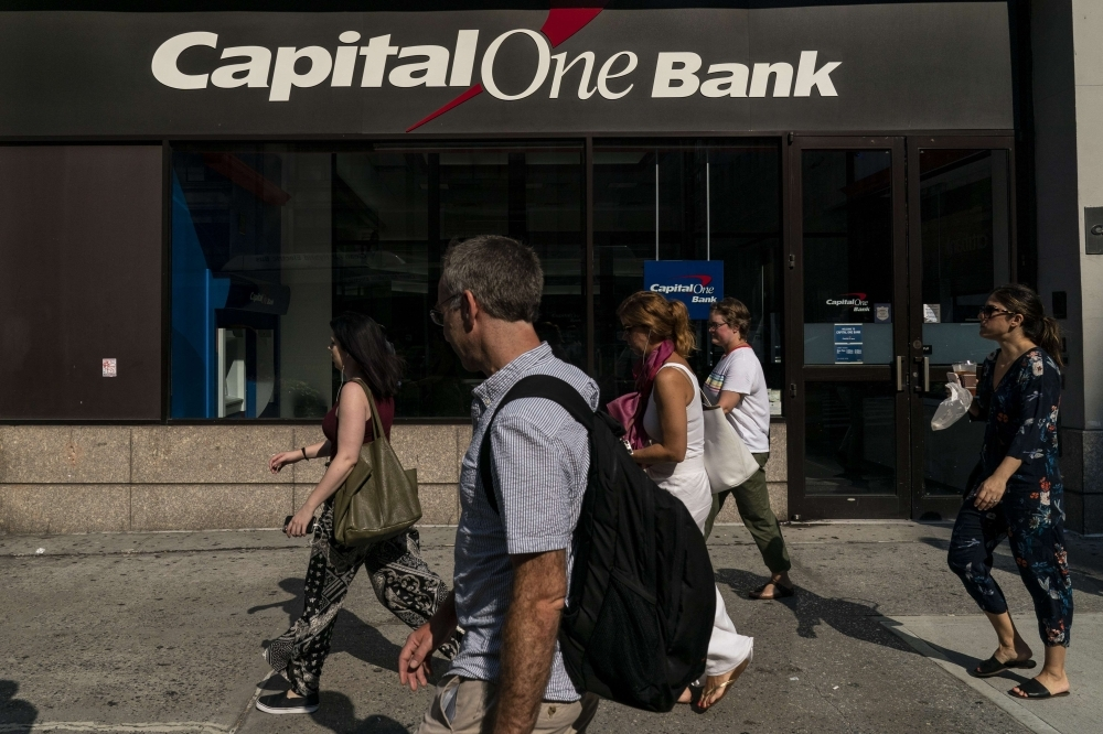 People walk past a Capital One bank in Midtown Manhattan in New York City on Tuesday. — AFP