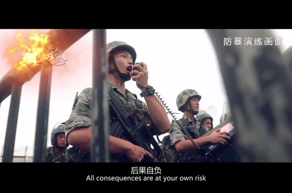 This screengrab taken from undated handout three-minute promotional video received on Thursday from China's People's Liberation Army (PLA) Hong Kong Garrison shows PLA soldiers warning