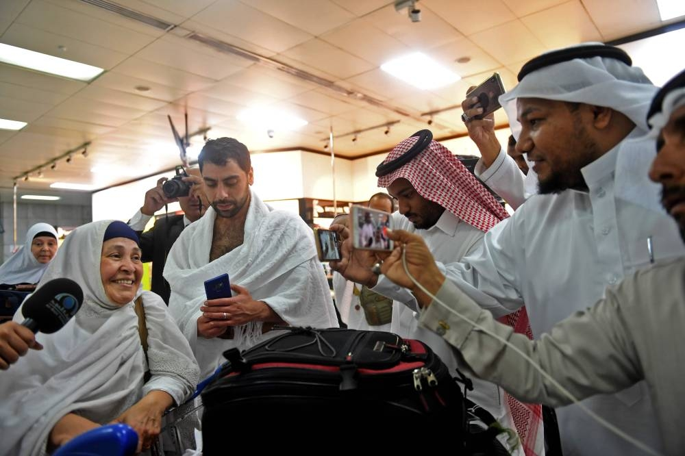 Families of victims of the March 2019 attack on mosques in New Zealand, arrive at Jeddah airport on Friday, prior to the start of the annual Haj pilgrimage in the holy city of Makkah.