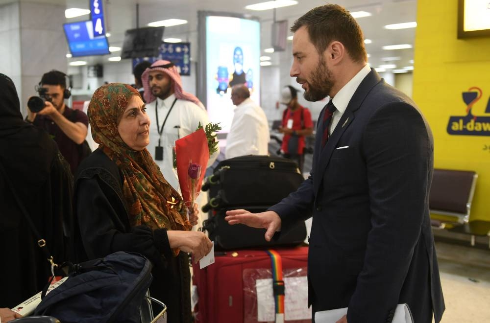 James Munro, Ambassador of New Zealand to the Kingdom, speaks with the families of victims of the Christchurch attack in New Zealand, upon their arrival at Jeddah airport. — AFP photos