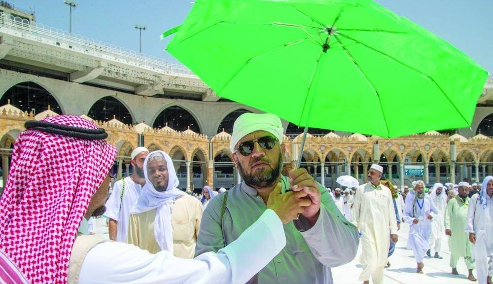 Pilgrims appreciated the gifts including umbrellas. — Courtesy photo