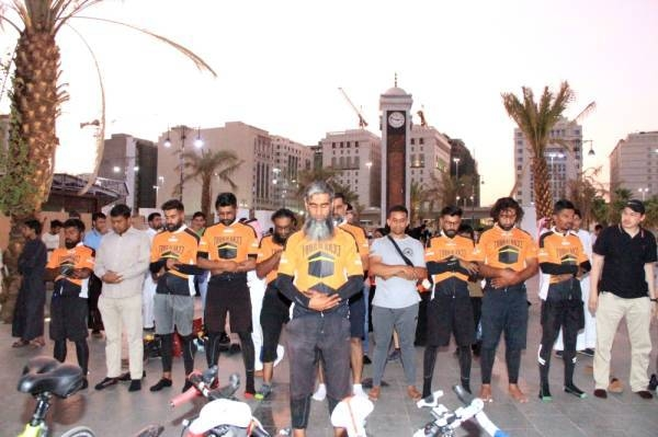 British cyclists offer prayers upon their arrival in the Prophet's City.