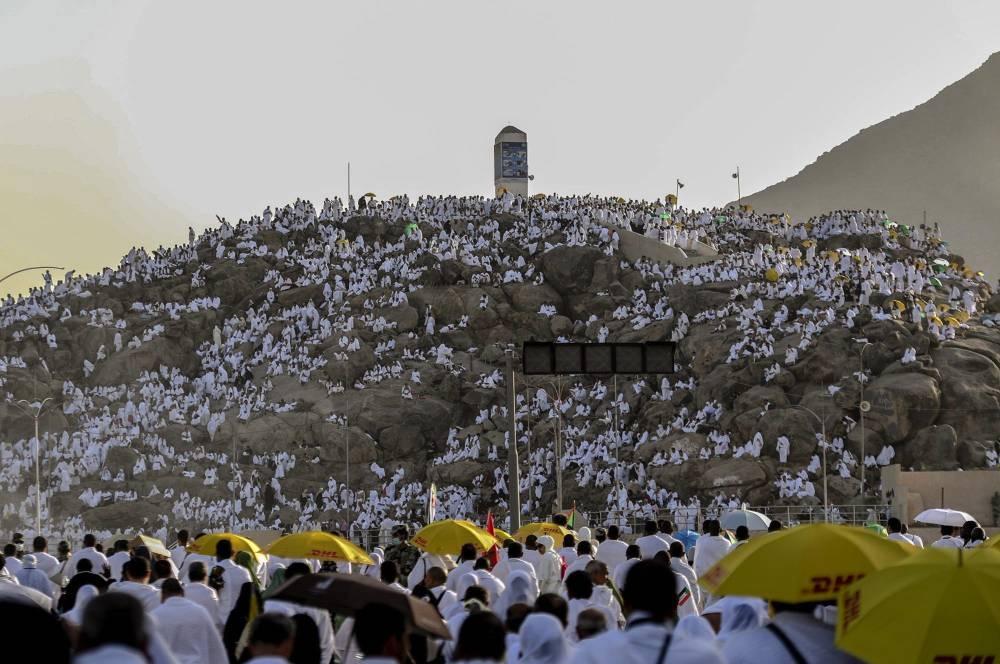 Pilgrims pray at Mount Arafat on Saturday. — SPA