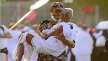 An elderly pilgrim is being carried by a Saudi security man. — SPA
