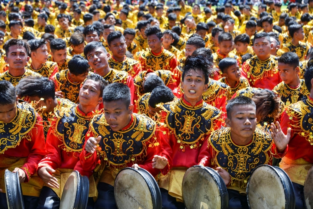 Performers take part in the Rapa'i Geleng dance, using a traditional tambourine, to celebrate Indonesia's 74th Independence Day in Blang Pidie, Aceh province on Saturday. -AFP