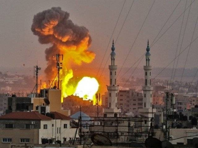 A picture taken on July 20, 2018 shows a fireball exploding in Gaza City during Israeli bombardment. -AFP