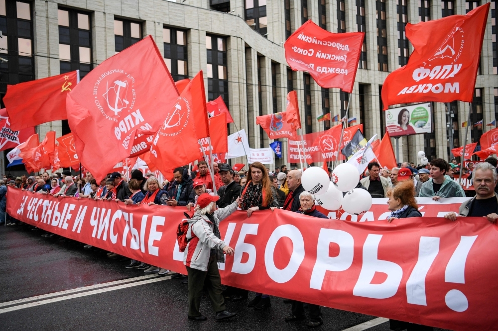 Russian Communist Party members and supporters attend a protest rally against the exclusion of some city council candidates from Moscow's upcoming election in central Moscow on Saturday. -AFP