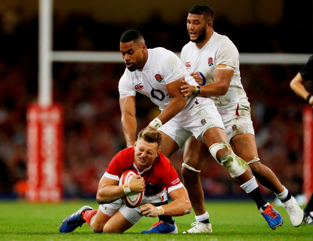 Wales' Dan Biggar in action with England's Joe Cokanasiga during Rugby World Cup warm-up match at Principality Stadium, Cardiff, Britain, on Saturday. — Reuters