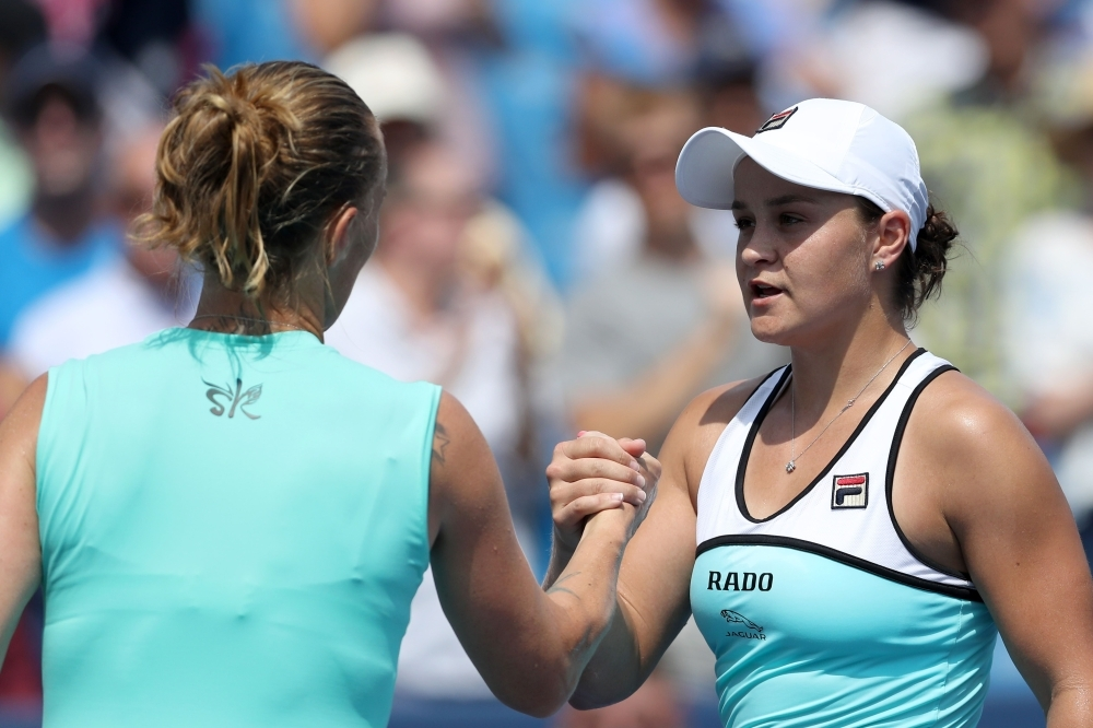 Ashleigh Barty of Australia (R) shakes hands with Svetlana Kuznetsova of Russia after losing in straight sets during Day 8 of the Western and Southern Open at Lindner Family Tennis Center in Mason, Ohio, on Saturday. — AFP